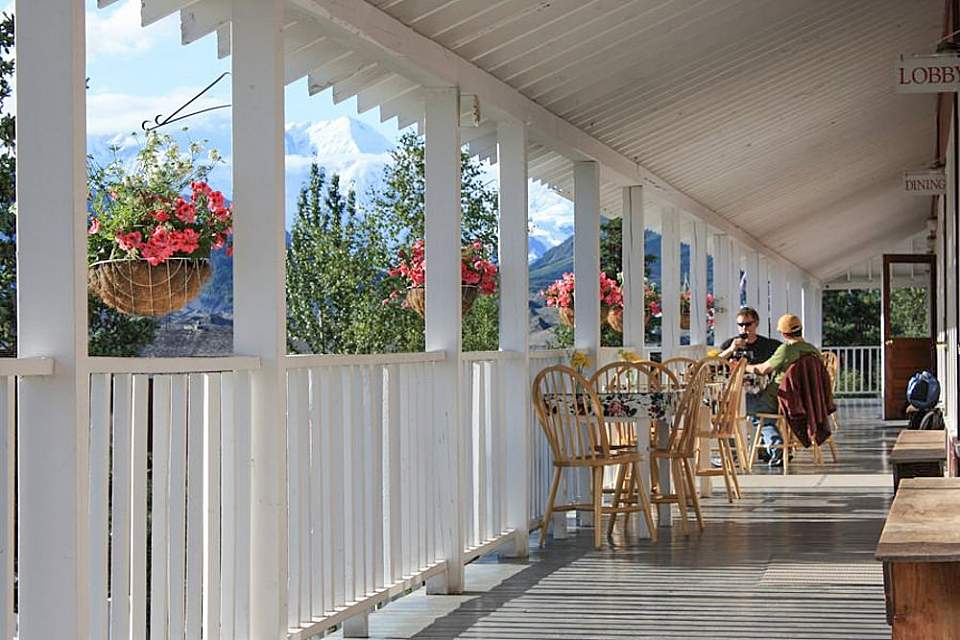 Dine or relax on the front porch, with views of Kennicott Glacier