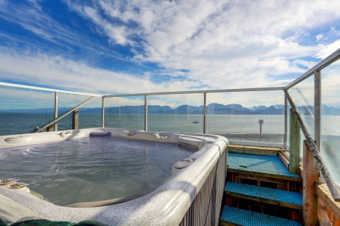 Hot tub with an oceanfront view.