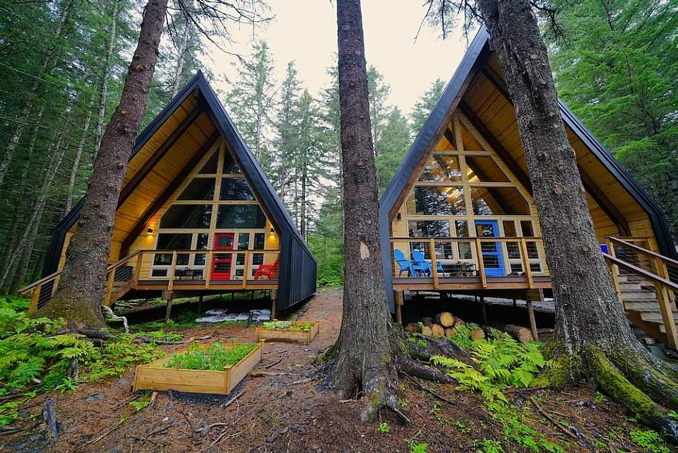 Two a-frame cabins situated in the woods near Seward, Alaska