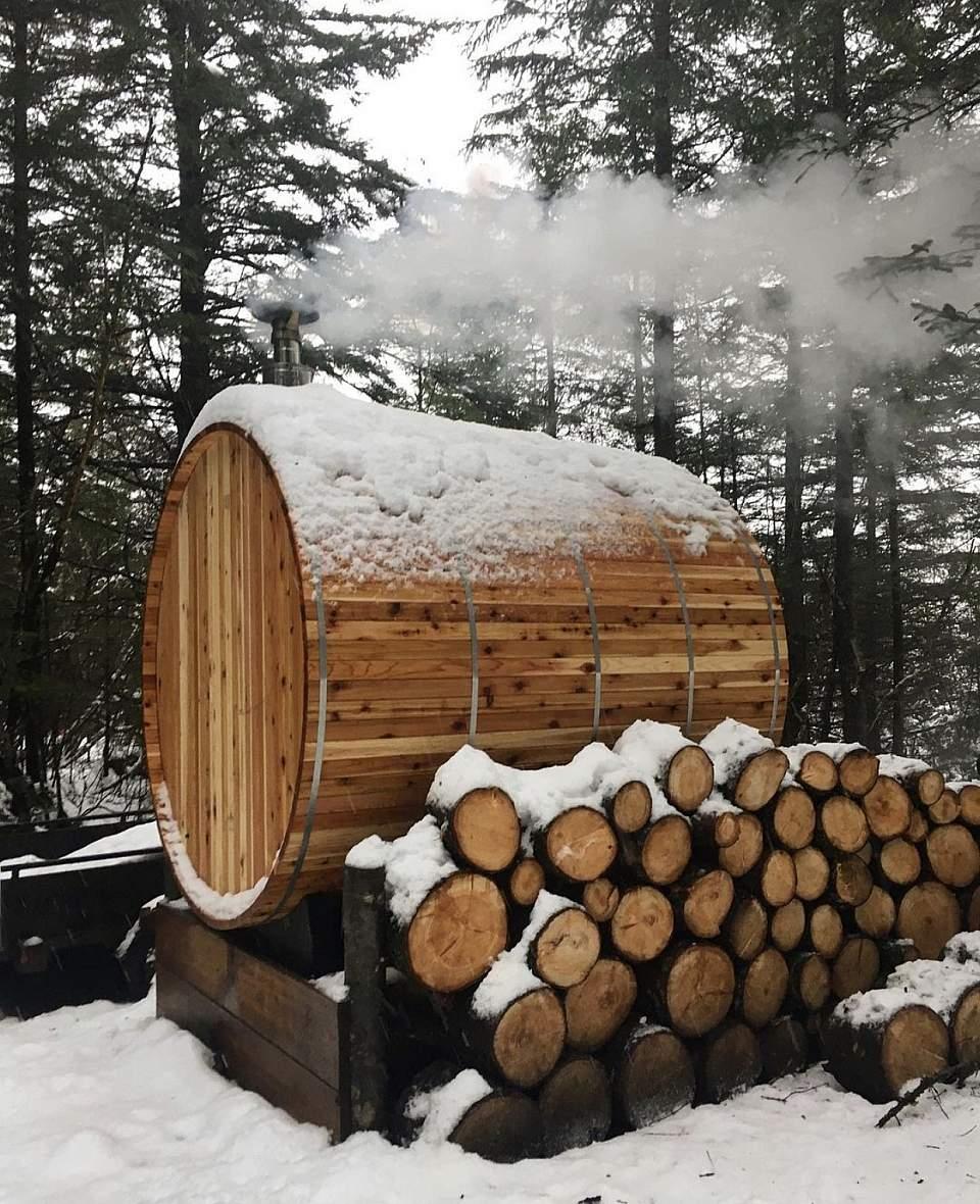 Wood barrel sauna in winter